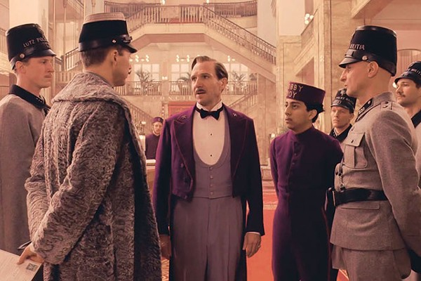 M. Gustave (Ralph Fiennes) and Zero (Tony Revolori) try to charm their way out of one of many sticky situations in The Grand Budapest Hotel - COURTESY PHOTO