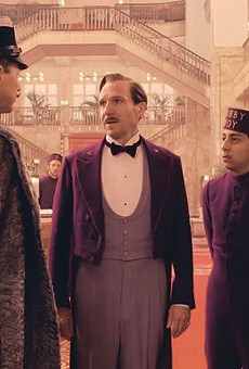 M. Gustave (Ralph Fiennes) and Zero (Tony Revolori) try to charm their way out of one of many sticky situations in The Grand Budapest Hotel