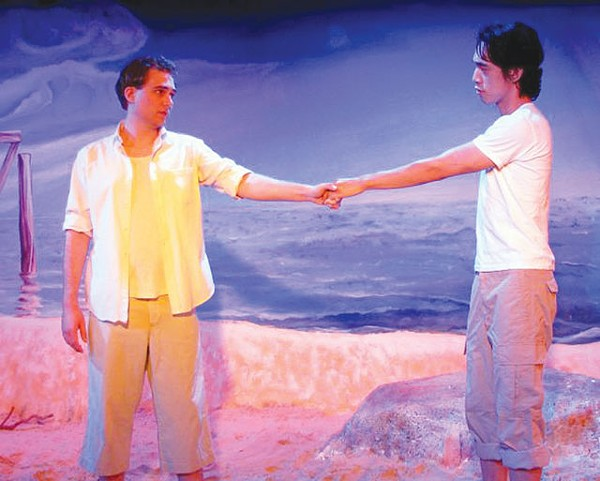 Mark McCarver and Jonathan Itchon hold hands in San Pedro Playhouse's Corpus Christi.