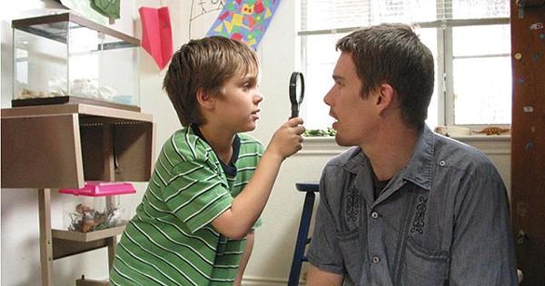 Mason (Ellar Coltrane) investigates his father (Ethan Hawke) in the film Boyhood - COURTESY PHOTO