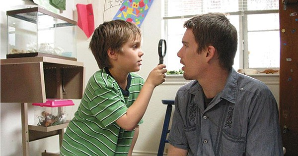 Mason (Ellar Coltrane) investigates his father (Ethan Hawke) in the film Boyhood - COURTESY PHOTO