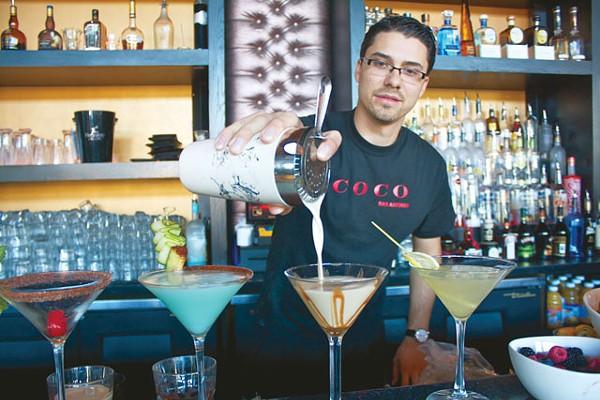 Mathieu Muckenstur mixes up some decadent cocktails at Coco. - VERONICA LUNA