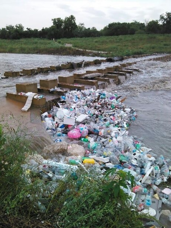 Trash from Fiesta clogs the San Antonio River. - SAN ANTONIO RIVER AUTHORITY