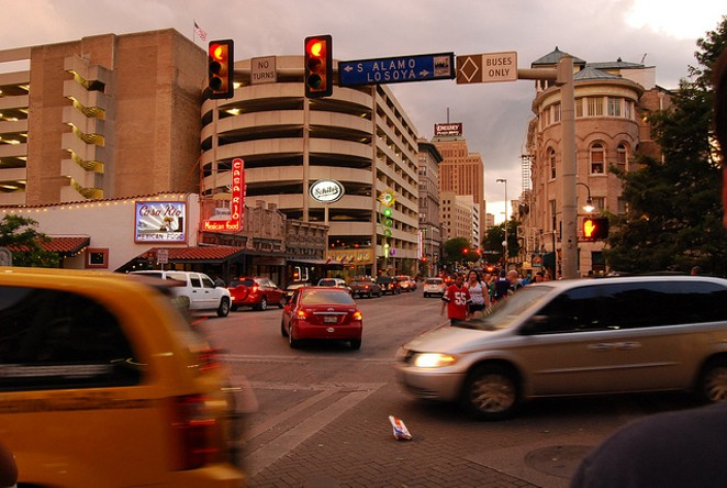 Cars pass through a downtown intersection. - VIA FLICKR USER LEARNINGLARK