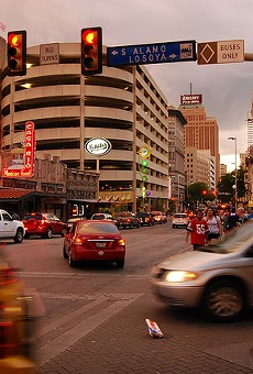 Cars pass through a downtown intersection.