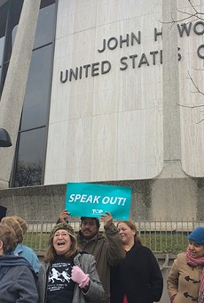 Members of the the Texas Organizing Project, Service Employees International Union of Texas, and Domesticas Unidas gathered at the John H. Wood Federal Courthouse Building on January 14, 2015, to oppose Governor-elect Greg Abbott lawsuit against President Barack Obama's executive action on immigration.
