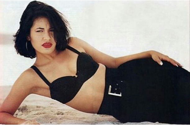Selena's highly coveted look: red lips, dark locks, bustiers, and high-waisted pants. - COURTESY