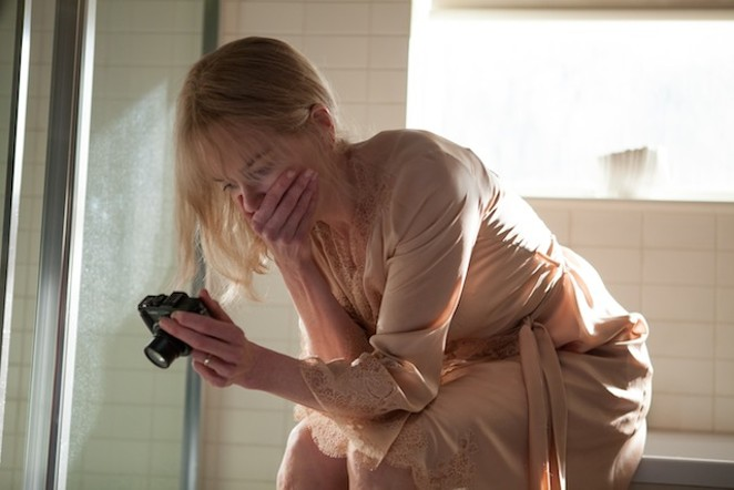 Troubled amnesiac Christine Lucas (Nicole Kidman) reviews her own video diary in 'Before I Go to Sleep.' - COURTESY