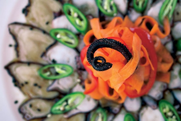 Octopus sashimi with Ponzu sauce and Serrano chile slices - ANA AGUIRRE