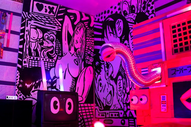 One room at Fox Motel was tranformed into a hentai-themed playroom, complete with a wall-mounted sex toy. - ANDREW LOPEZ