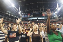 "PHOTOS BY MICHAEL BARAJAS - Organizers said over 30,000 attended the Perry-prompted prayer rally in Houston's Reliant Stadium Saturday, dubbed ""The Response."""
