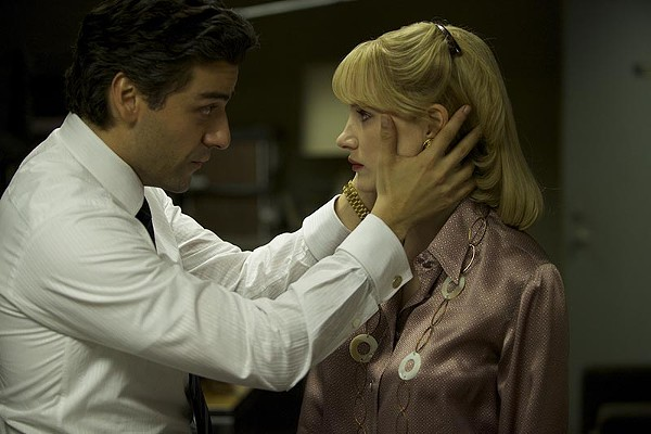 Oscar Isaac and Jessica Chastain have a staring contest in a tense moment from A Most Violent Year - COURTESY