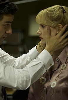 Oscar Isaac and Jessica Chastain have a staring contest in a tense moment from A Most Violent Year