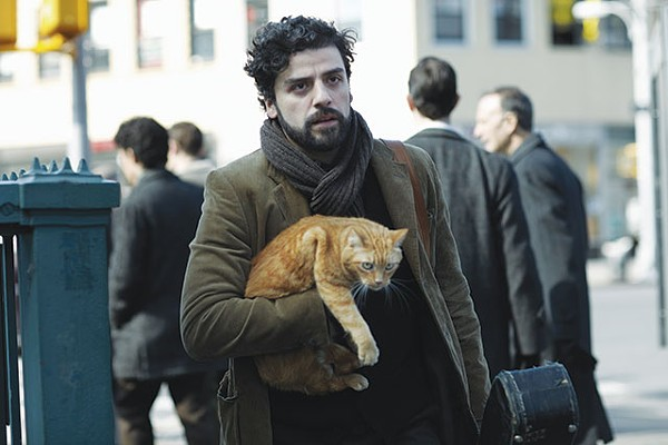 """Oscar Isaac as Llewyn Davis: """"I don't need anything ... except this cat ... and this guitar ... and that's all I need ... and this winter coat ... and this ..."""" - COURTESY PHOTO"""