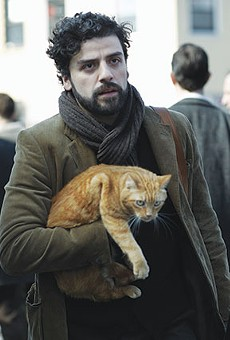 "Oscar Isaac as Llewyn Davis: ""I don't need anything ... except this cat ... and this guitar ... and that's all I need ... and this winter coat ... and this ..."""