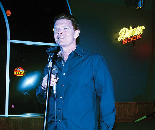 Owner Rick Rice at the karaoke mic - ESSENTIALS210