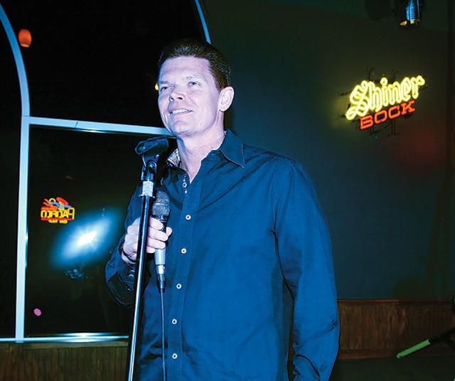 Owner Rick Rice at the karaoke mic - ESSENTIALS210