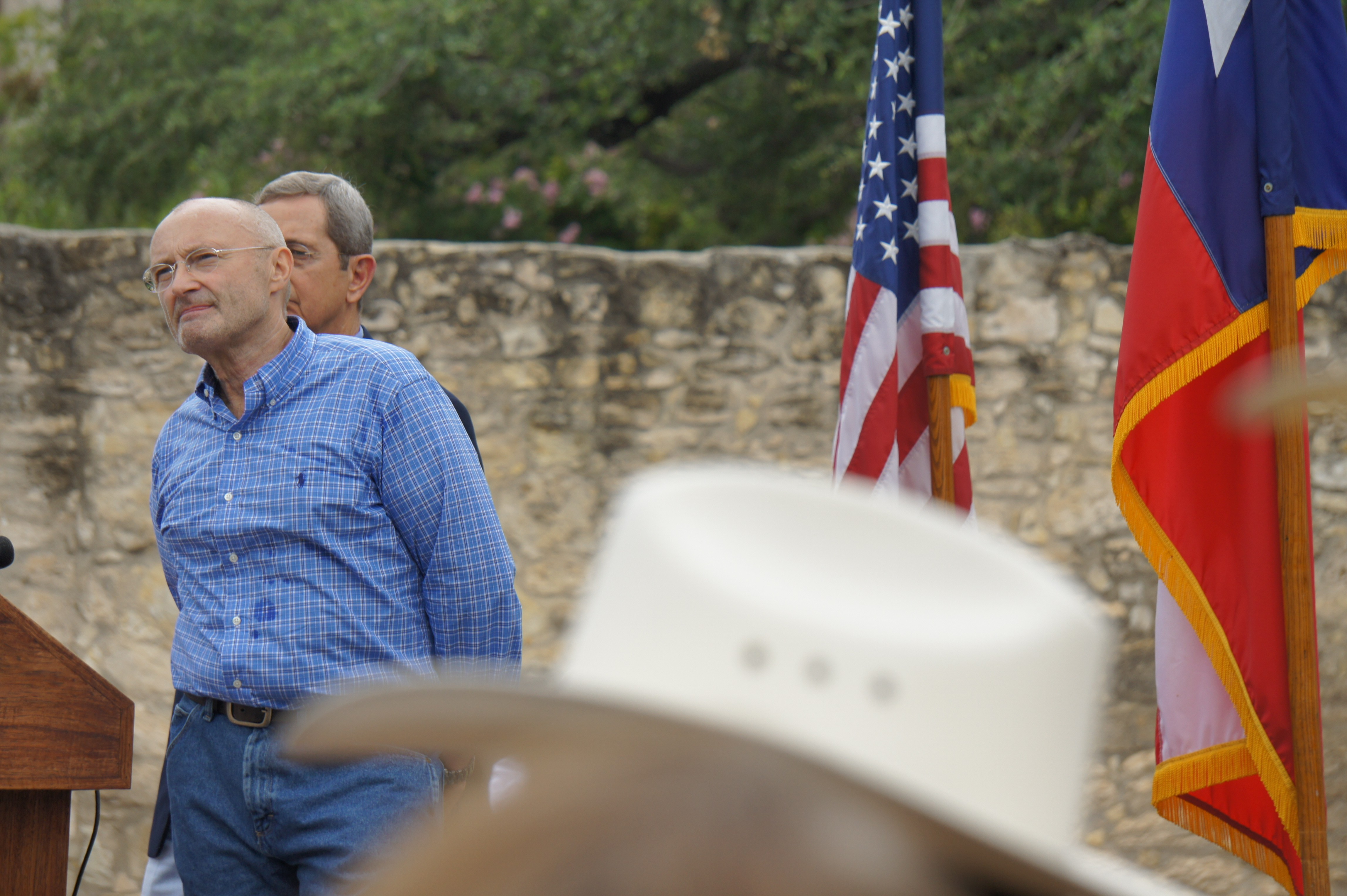 Former Genesis member and Alamo enthusiast Phil Collins is joined onstage by Texas Land Commissioner Jerry Patterson in front of the Alamo on June 26, 2014. Collins formally announced his intention to donate his entire private collection of Texas Revolution memorabilia to the state of Texas. - ALBERT SALAZAR