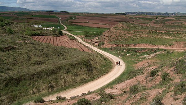 Pilgrims Misa and William walk a stretch of the Camino that passes through La Rioja in Spain - COURTESY