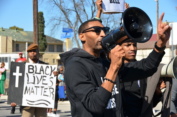 Mike Lowe of SATX4 leads the die-in at the Martin Luther King, Jr. Day March in San Antonio on January 19, 2015. - ALBERT SALAZAR