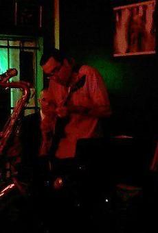 Peña on the guitar inside Saluté in November 2010.