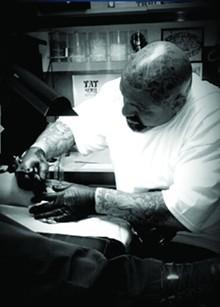 Revolution Ink tattoo artist Pikaso Soliz. - COURTESY