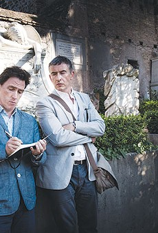 Rob Brydon, left, and Steve Coogan take a break from eating to hang out in a cemetery