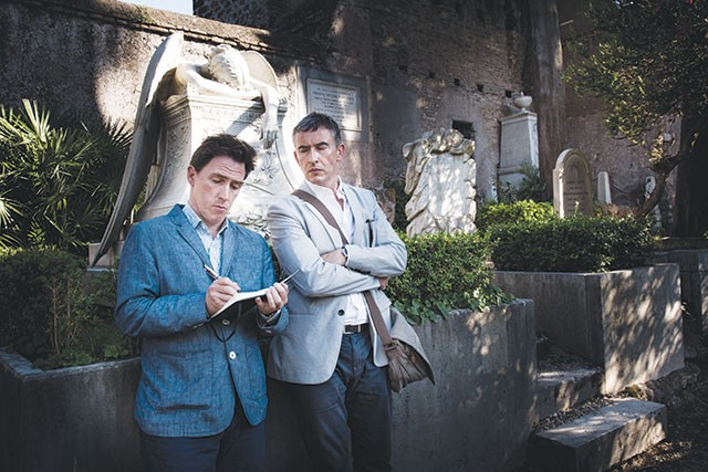 Rob Brydon, left, and Steve Coogan take a break from eating to hang out in a cemetery - COURTESY PHOTO
