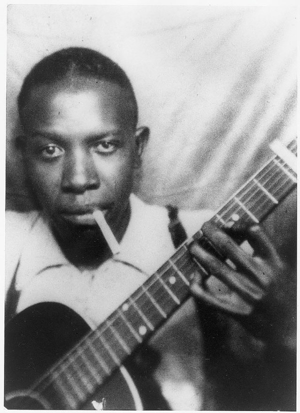 Robert Johnson in the early '30s, in one of the only two verified photographs of him. - COURTESY PHOTO
