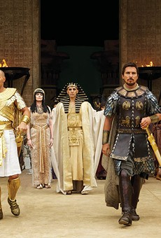 Seti (John Turturro, background) presents the future leaders of Egypt: Ramses (Joel Edgerton, left) and Moses (Christian Bale)