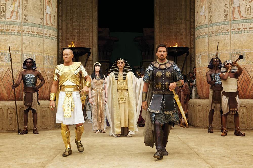 Seti (John Turturro, background) presents the future leaders of Egypt: Ramses (Joel Edgerton, left) and Moses (Christian Bale) - COURTESY
