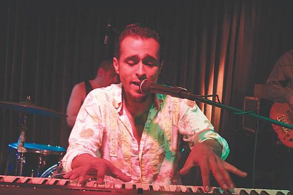 Sexto Sol's Sam Villela channeling Sly Stone. - VERONICA LUNA