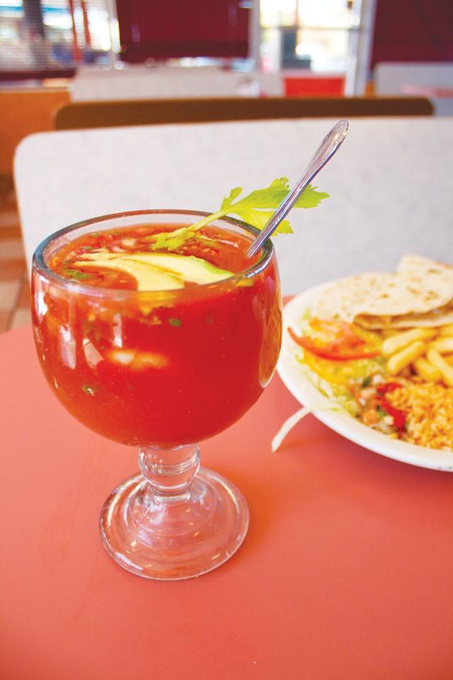 Shrimp cocktail and shrimp quesadilla from Taqueria Vallarta. - VERONICA LUNA