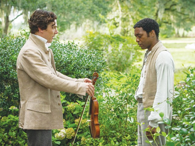 Shut up and play your violin—Plantation owner William Ford (Benedict Cumberbatch) and slave Solomon Northup (Chiwetel Ejiofor) - COURTESY PHOTOS
