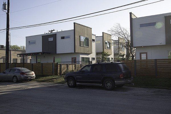 Signs of new life: New apartment complex forms part of East Side's revitalization. - COURTESY