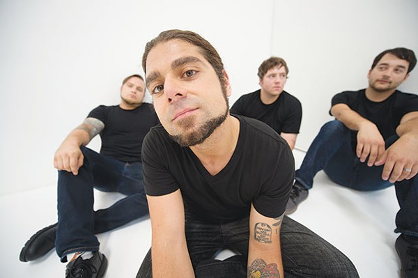 Singer-guitarist Claudio Sanchez and Coheed and Cambria on planet Earth, Travis Stever is on the left - COURTESY PHOTO
