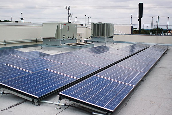 Solar panels on Hill Electric Co.'s rooftop