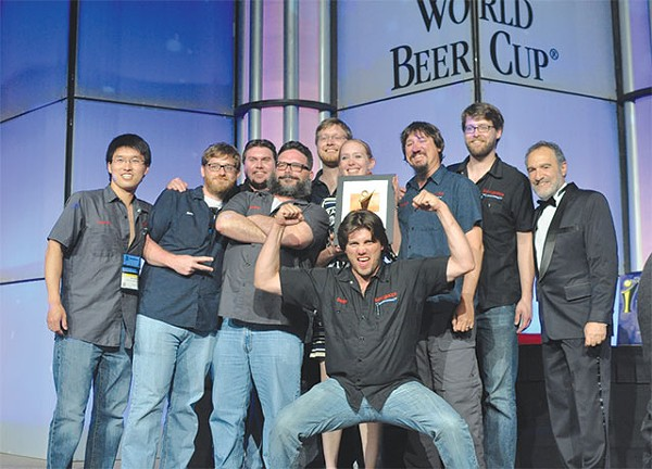 St. Arnold's brew team accepts their bronze WBC award for their Santo dark lager - ©2012 JASON E. KAPLAN