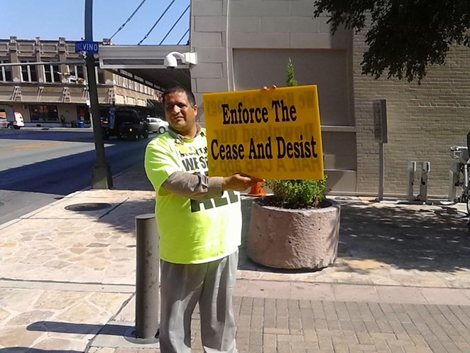 A taxi driver protests outside San Antonio's City Council chambers last year. The Alamo City passed strict ride-share regulations, prompting both Uber and Lyft to stop doing business in the city. - MARK REAGAN