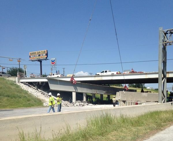 Workers remove a beam from I-35 and New Braunfels earlier this year. - TXDOT SAN ANTONIO