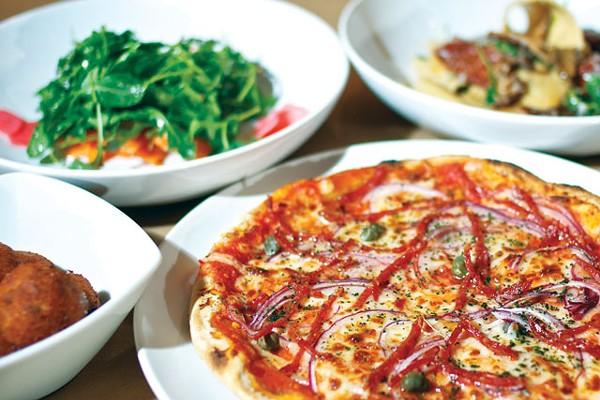 """The bomb"" pizza backed up by arancini, house salad with arugula, and maltagliati pasta. - STEVEN GILMORE"