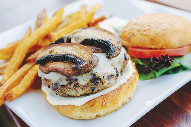 The house burger with pepper jack cheese and grilled 'shrooms - JOSH HUSKIN
