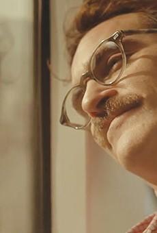 Theodore (Joaquin Phoenix), pining for his phone