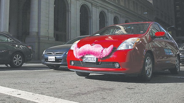 This vehicle's fuzzy pink mustache represents Lyft - COURTESY PHOTO
