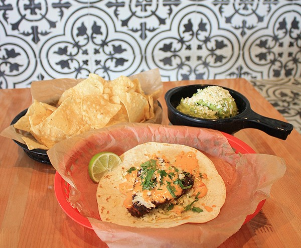 Though not always the most visually appealing, tacos at Torchy's tend to hit the spot. - SARAH FLOOD