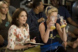 Tina Fey plays the straight woman to Amy Poehler's ... eye-breast-pumping woman.
