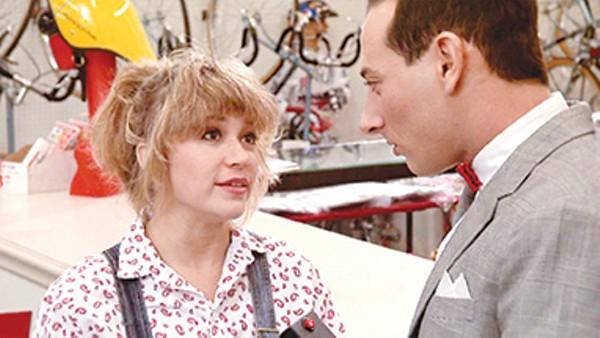 "Elizabeth ""E.G."" Daily as Dottie and Paul Reubens as Pee-wee Herman in 'Pee-wee's Big Adventure.' - COURTESY"