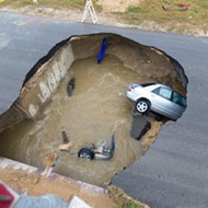 Sinkhole Devours Two Cars and One Person On Southwest Side