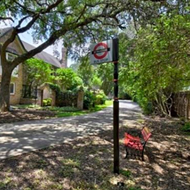 This San Antonio home modeled after a British estate includes an on-site pub and UK phone booth