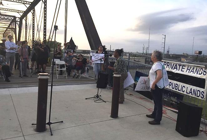 Neighborhood activist Nettie Hinton addresses the crowd at Hays Street Bridge on Monday. - SANFORD NOWLIN